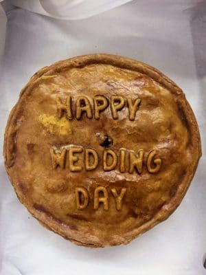 Thornton's Bakehouse and Butchers Bespoke Pork Pie with the words happy wedding day